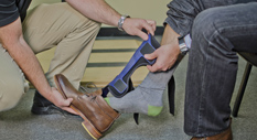 putting prosthetic foot into shoe