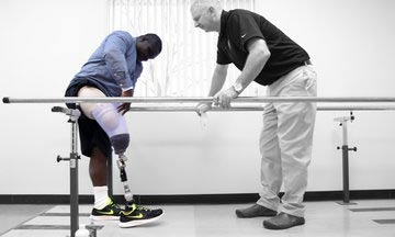 doctor and patient with prosthetic leg