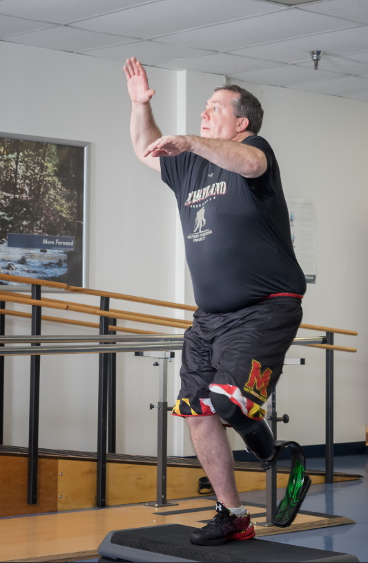 MCOP client with a prosthetic leg exercising in one of our facilities