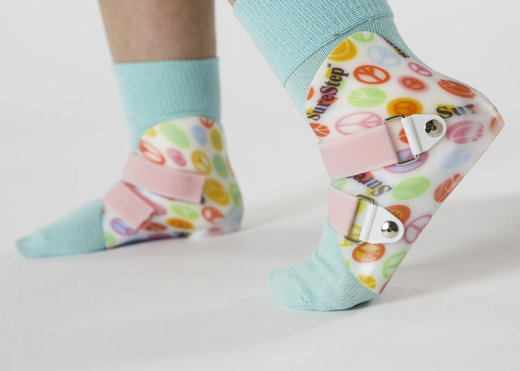 Colorful supramalleolar Orthosis (SMOs) being worn by a patient on both feet