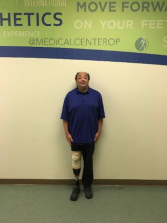 Photo of MCOP D.C. client Reuben standing upright without the aid of a wheelchair, walker, or cane